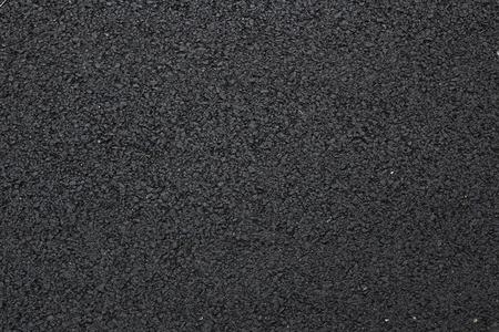 shiny black: Black shiny new asphalt abstract texture background.