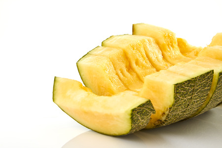 Hamigua Melon cut into slices, Hami Melon, Hami Cantaloupe isolated on white background.