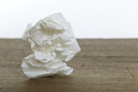 crumple: White Crumple paper ball on old wood desk