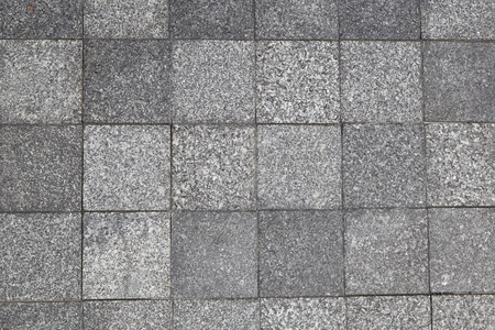 Gray square pavement. seamless tileable texture. stock photo