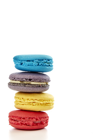 macaron pastry, blue, pink, yellow, purple on white background