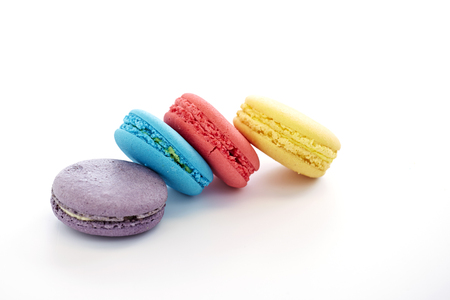 French colorful macarons yellow, purple, blue, pink isolated on white Stock Photo
