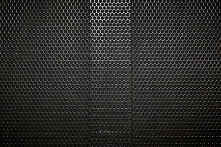 full of holes: speaker grille texture background Stock Photo