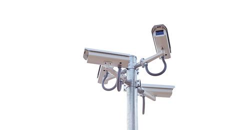 Four CCTV surveillance cameras on a pole