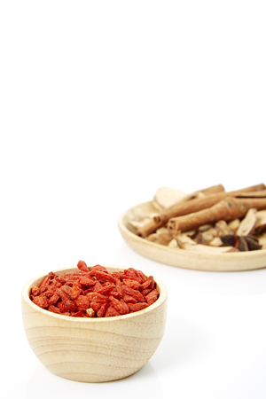 Cinnamon, star anise, cardamom, galangal,  on a white background. Stock Photo