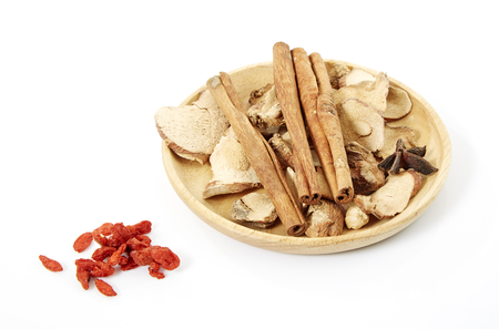 ajwain: Cinnamon, star anise, cardamom, galangal,  on a white background. Stock Photo