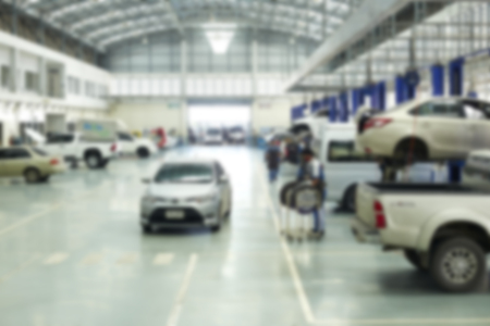 auto repair: auto repair service station blurred background Stock Photo