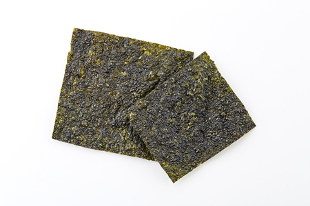 Crispy and dry seaweed isolated on white background