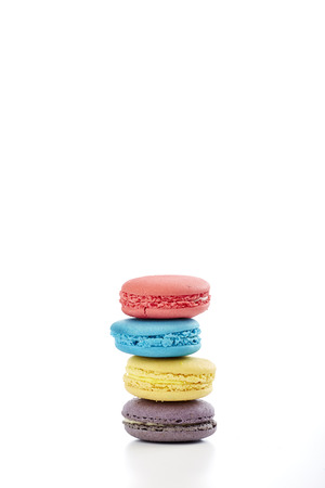 strawberry jam sandwich: macaron pastry, blue, pink, yellow, purple on white background