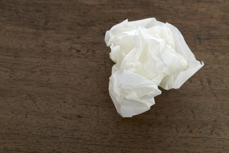 hankie: White Crumple paper ball on old wood desk