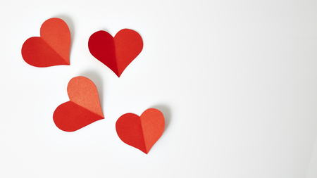 Red paper hearts isolated on white background 写真素材