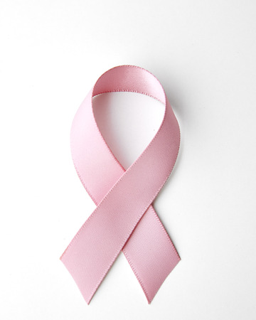 Pink breast cancer ribbon isolated on white Фото со стока