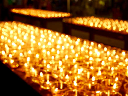 Blurred background gold diamond store.Group of candle lights pattern Candlelight of Hope and Faith