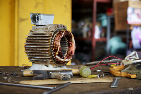 Repair Old disassemble electric motor show wiring coil during replace bearing
