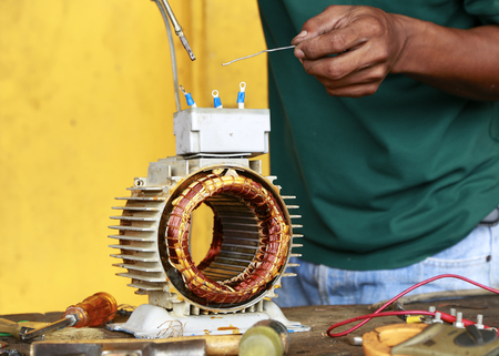 repairman during maintenance work of electric motors Stock Photo