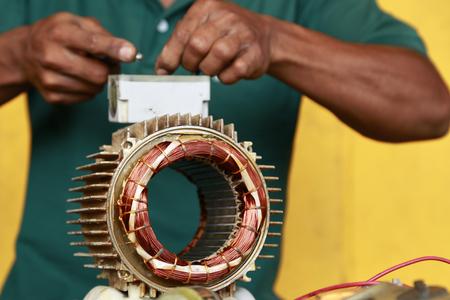 repairman during maintenance work of electric motors 写真素材