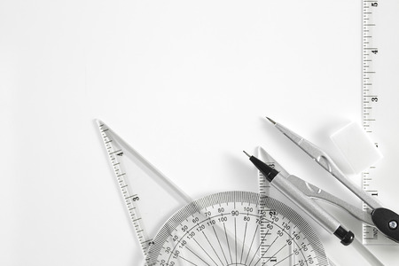 Geometry set with compass, ruler and protractor  on white background