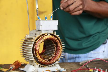 machinery: repairman during maintenance work of electric motors Stock Photo