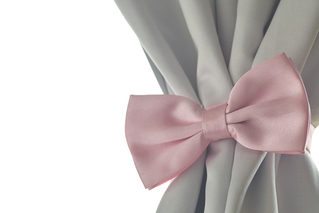 desing: Pink bow tie beautiful modern grey curtains in living room Stock Photo