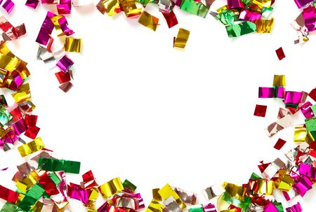 Colorful confetti on white background. Holiday or party background Stock Photo