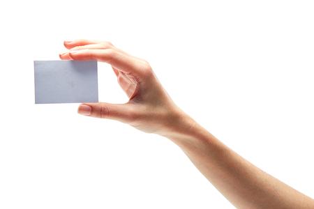 Female hand holding card isolated on white Stock Photo