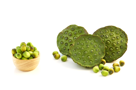Lotus seeds put in a wooden cup on a white background Stock Photo