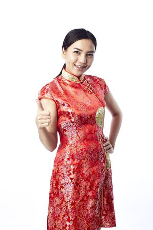 Asian girl greeting in traditional chinese new year stock photo asian girl greeting in traditional chinese new year stock photo 93715120 m4hsunfo