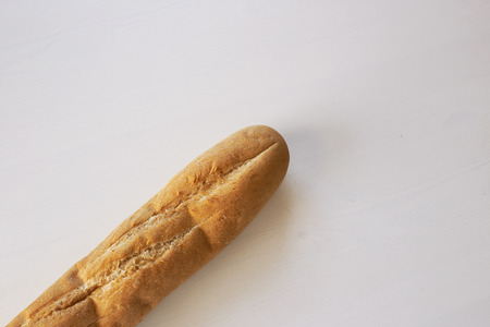 French bread baguette on a table white background. Top view with space for your text Stock Photo