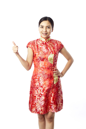 Asian girl greeting in traditional chinese new year stock photo asian girl greeting in traditional chinese new year stock photo 94416801 m4hsunfo