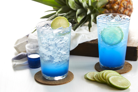 Ice Blue Lime soda for summer on white wooden table, Concept cool drink