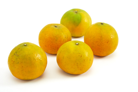 fresh yellow oranges isolated on white background