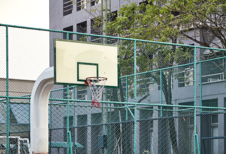 white plate of basketball hoop standing outdoor in a community park  free sport and healthy infrastructure concept Stock Photo