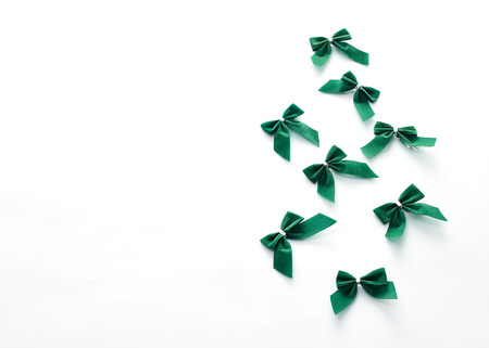 St Patricks Day side border of green bows over a white background Stock Photo