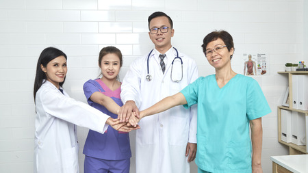 Asian  doctor and nurse madical team in hopital, Different ages, illness consultant Banque d'images
