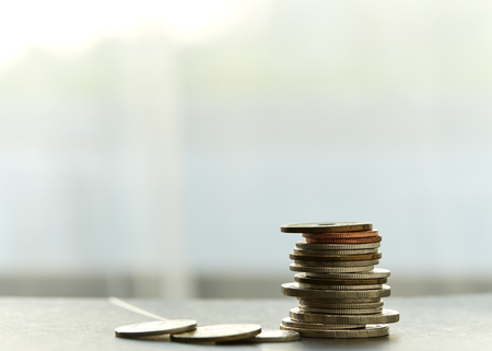 Coins stacked on each other in different positions, deposit Concept Stock Photo