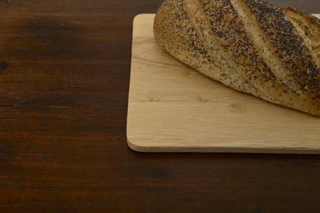 Fresh bread on wooden old table. Top view with space for your text