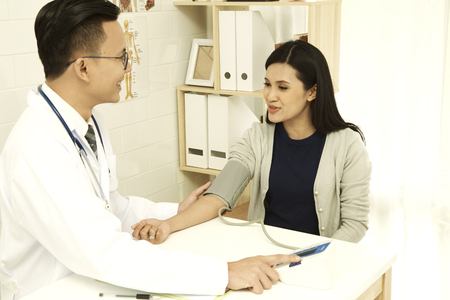 Asian women are giving doctor a checkup at the hospital.