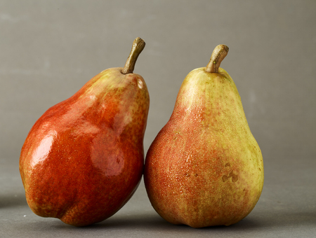 Studio shoot, Ripe Red Pear on grey background Stock Photo