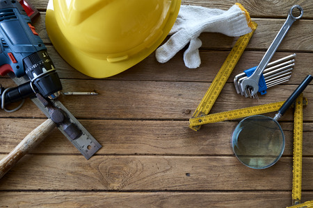 Tools and helmet on the wooden floor. Image with copy space. Labor day concept Stock Photo