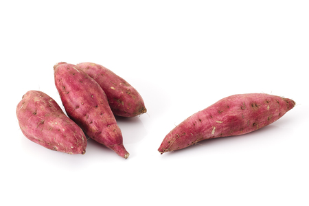 Red sweet potatoes isolated on white background Imagens