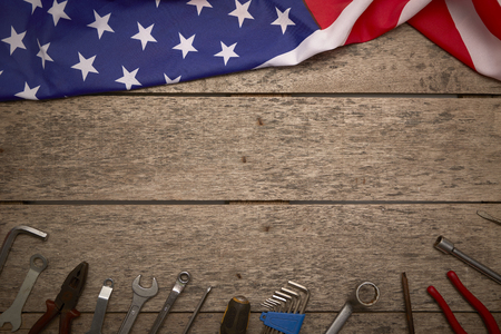 Day of America holidays, flag with tools on an old wooden background, concept of significant days