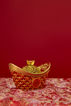Chinese New Year decoration on a red background good fortune and lump of gold.
