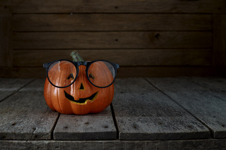 smiling pumpkin jack o' lantern with spectacles