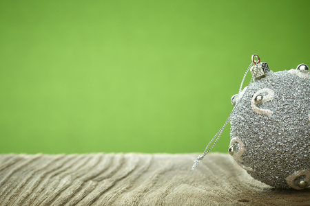 Christmas balls on silver on wood table green background with copy space for text 版權商用圖片