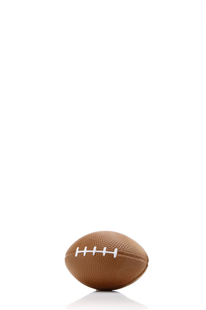 Toy American football white background, close-up