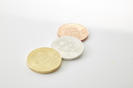 Three Bitcoins Coins on white background, studio shot