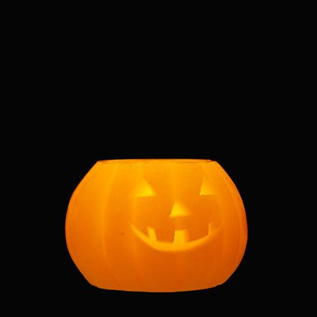 funny halloween jack o lantern pumpkin on black background stock