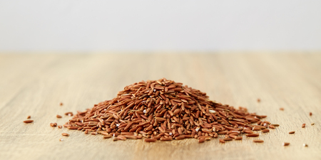 close up rice red organic food healthy on wooden, [Tup Tim Chum Phae Rice] Stock Photo