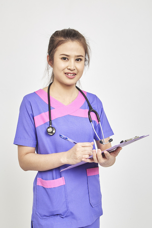 Happy Asians young female family doctor holds blue folder with documents