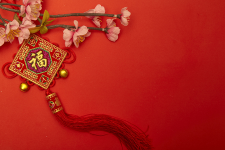 "Chinese new year 2020 ornament on red paper with Chinese letter ""FU"" meaning meaning ""fortune"" or ""good luck, gold ingot, Chinese lamp"